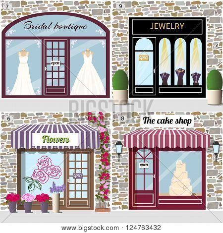 Set of wedding shops. Bridal boutique, jewelry, flowers and the cake shop. Building facade of stone. Vector illustration eps 10.