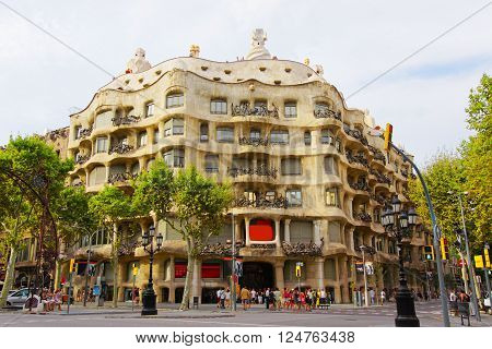 BARCELONA SPAIN - AUGUST 14 2011: Casa Mila in Barcelona in Spain. Also called as La Pedrera. In English it is called as Miracle Home or The Quarry. It was designed by Antoni Gaudi Spanish artist