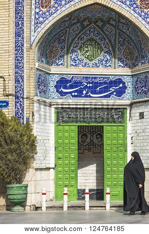 Esfahan Iran - February 8,  2016 - Muslim woman with traditional chador on the street. Iran 2016