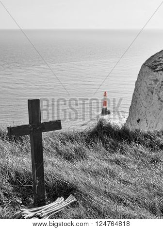Cross and lighthouse at Beachy Head, United Kingdom