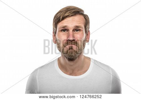 Sad young man. Isolated on white background.
