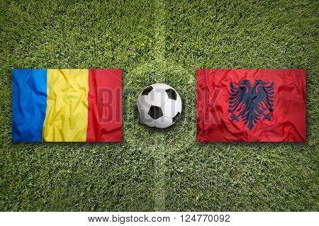Romania vs. Albania flags on green soccer field, Group A