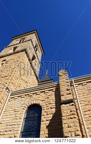 cathedral spire set against the deep blue sky