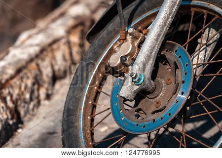 Details of old rusty motorbike wheel, rusty concept.