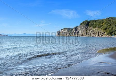 the Pacific coast of the bay on the Kamchatka Peninsula in the summer