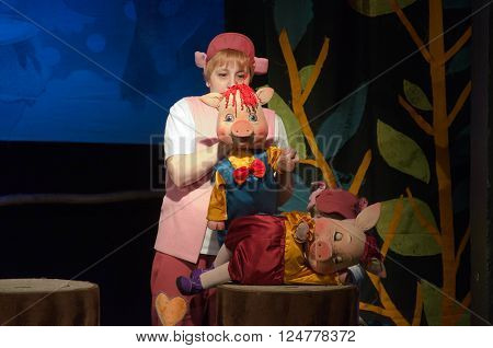 DNIPROPETROVSK, UKRAINE - APRIL 3, 2016: Three piglets performed by members of the Dnipropetrovsk Puppet Theatre.