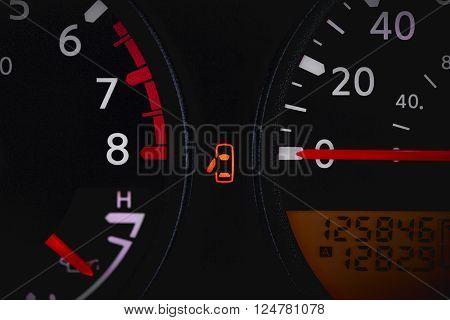 Car dashboard showing door ajar warning light