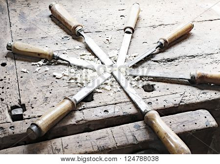 Series Of Many Sharp Steel Blades Many Chisels And Sawdust Chippings