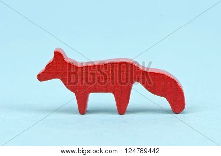 small wooden red fox children toy on blue background ** Note: Soft Focus at 100%, best at smaller sizes