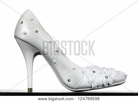 A female white wedding shoes closeup on white background