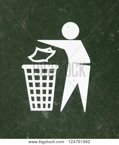 Close-up of a green bin, icon of man trowing something in bin