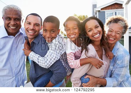 Outdoor group portrait of black multi generation family
