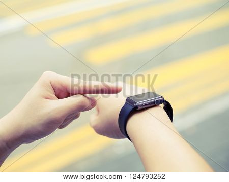 Man using wristwatch at outdoor