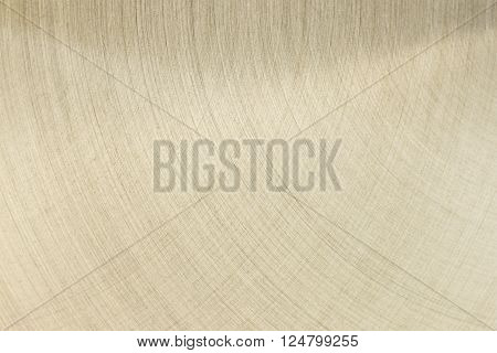 The golden polished metal surface. The background.