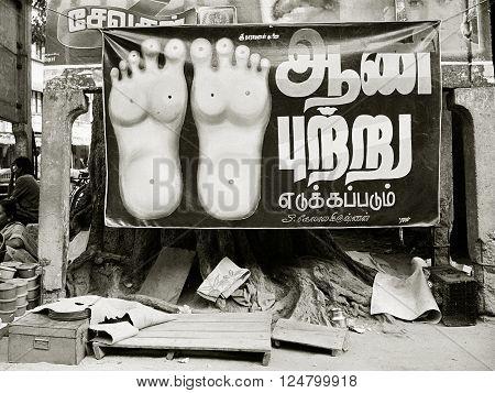 MADURAI INDIA - June 22 1992: A poster advertises street-side reflexology on June 22 1992 in Madurai Tamil Nadu India.