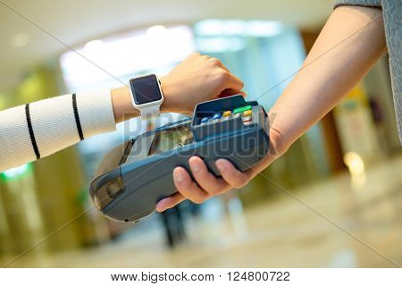 Customer using smart watch to pay