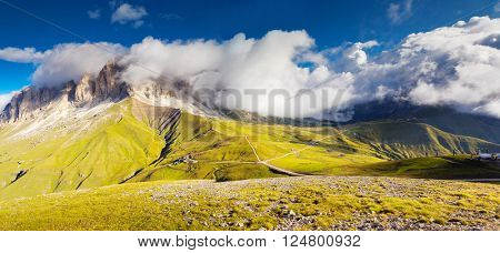 View of the foggy Gardena valley. National Park Dolomites (Dolomiti), pass Sella. Location Sassolungo and Sella group, South Tyrol, Alp, Italy, Europe. Dramatic and picturesque scene. Beauty world.