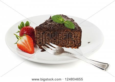 Chocolate Cake and Stawberries on a plate isolated on white background