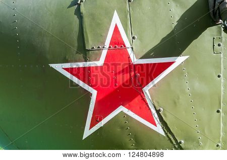 russian red star painted on khaki background of tank