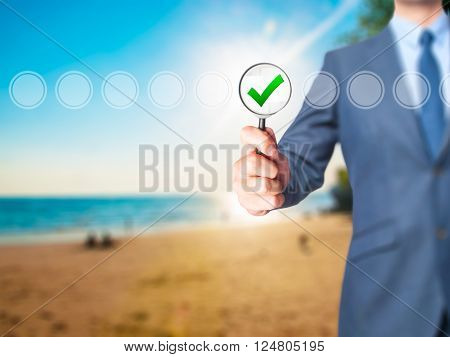 Businessman Magnifying Glass Check Mark On Virtual Screen.