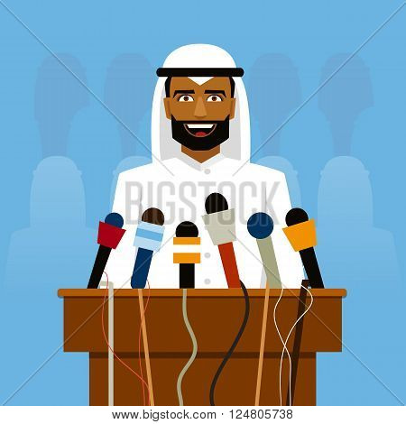 Arab politician speaking before reporters and microphones on a blue background.