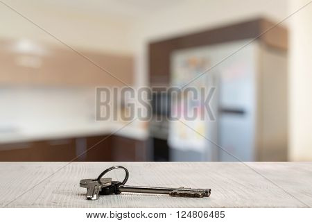 keys on white wooden table in the kitchen