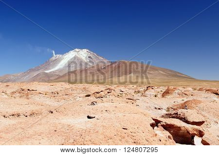 South America - The surreal landscape in the Eduardo Avaroa National Reserve of Andean Fauna near Chilean border. The picture present volcano Ollague