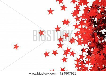 many red stars confetti on white background