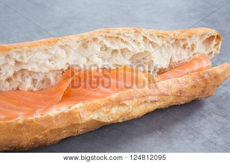 Close Up Of Fresh Salmon Sandwich On Grey Table And Place Mat
