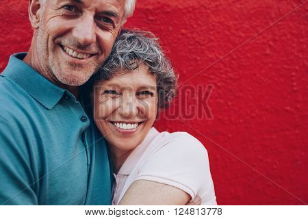 Cheerful Mature Couple Embracing Each Other