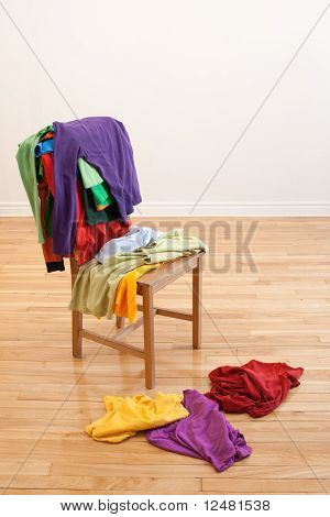 Colorful Messy Clothes On A Chair