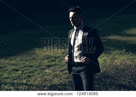 Handsome Man Poses On Landscape