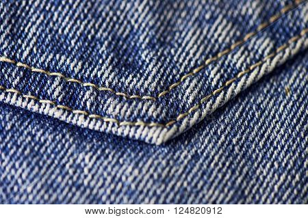 Blue denim jeans texture, background with stitching