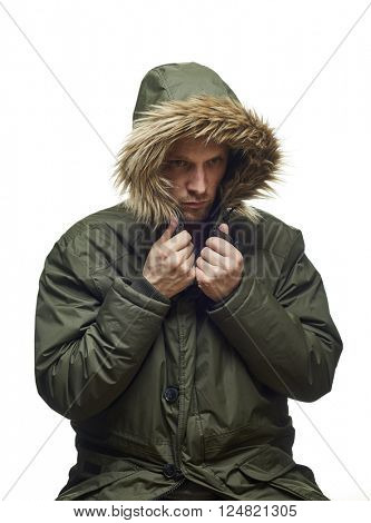 High key studio portrait of young adult caucasian model wearing winter coat with hood on looking sideways. Isolated on white.