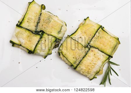 Oven baked courgettes stuffed with cheese, garlic and herbs. Courgette recipe in the oven. Top view with copy space.