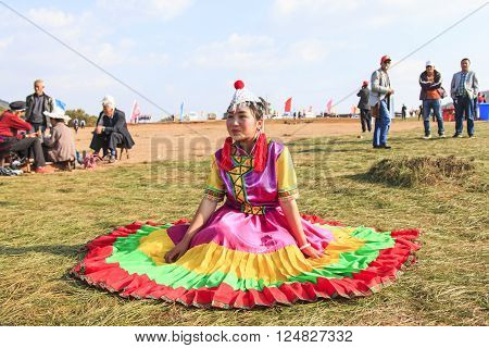 Heqing, China - March 15, 2016: Chinese Girl In Traditional Chinese Clothing During The Heqing Qifen