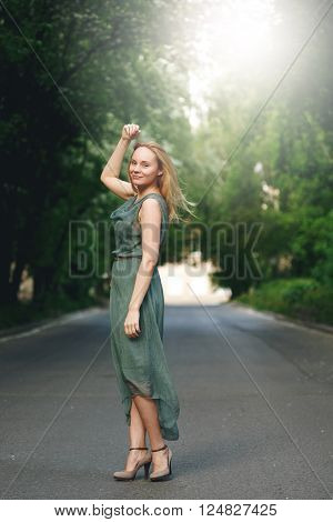 Young Woman Standing On The Road
