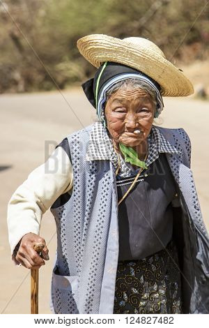 Heqing China - March 15 2016: Old Chinese woman dressed with traditional Bai clothing during the Heqing Qifeng Pear Flower festival