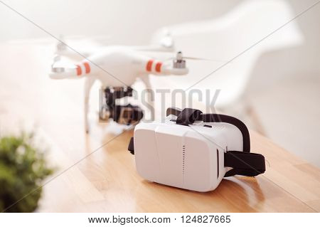Modern view.  Close up of wireless flying and virtual reality devices  lying on the table