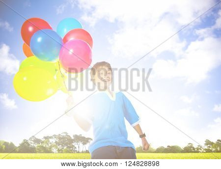 Happy Boy Outdoors With A Dozen Of Helium Balloons Concept