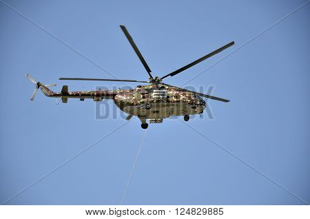 Sliac Slovakia - August 27 2011: Flight display of Helicopter Mil Mi-17M (serial number: 0823) which belong in Slovak Air Force in air show