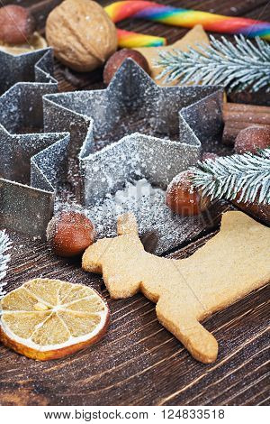making Christmas cookies bakeware and nuts background