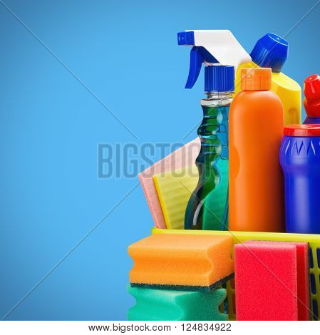 cleaners supplies and cleaning equipment on blue background