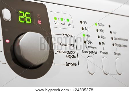 Closeup of a control panel of white washing machine