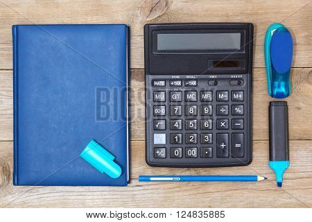 Office Set: diary calculator stapler and a marker flat lay