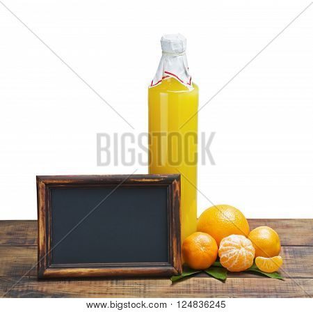 bottle of juice from citrus fruits and blackboard