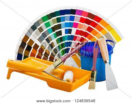 plastic can with paint roller brushes and bright palette of colors