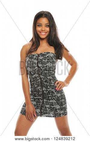 Beautiful young woman wearing a short dress isolated on a white background