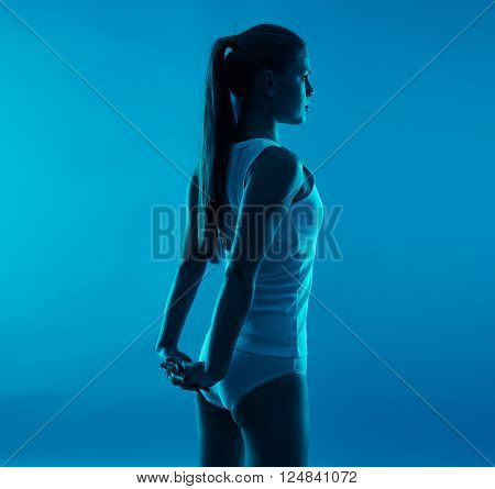 Scoliosis therapy concept. Young sporty woman stretching body.