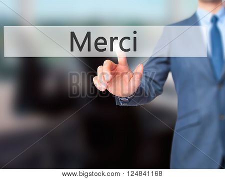 Merci - Businessman Hand Pressing Button On Touch Screen Interface.
